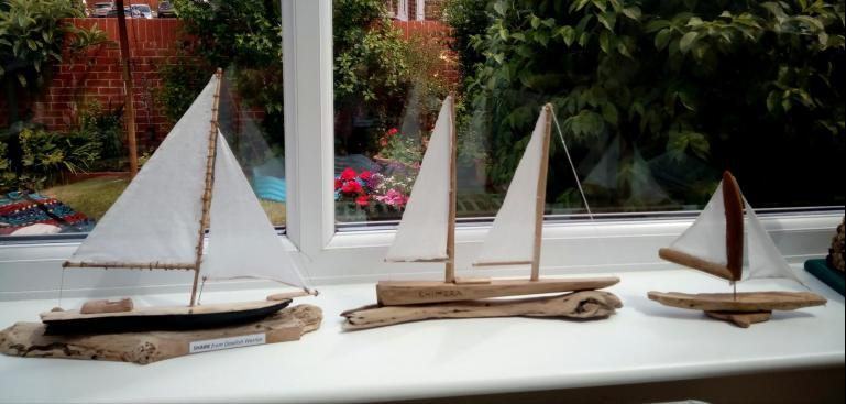 A collection of drift wood ships by Dave Logan