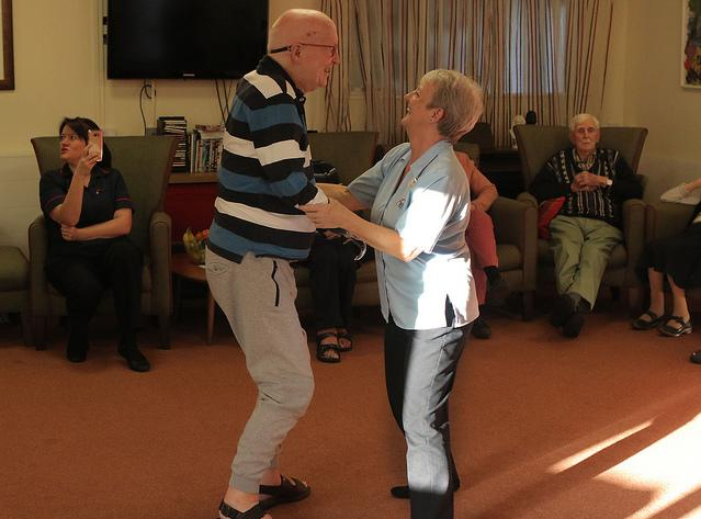 Two people dancing in a care home