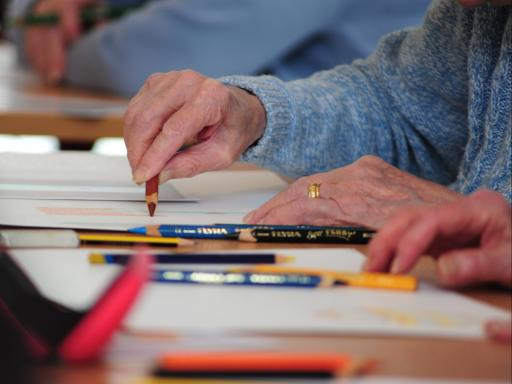 Close up Photo of a person drawing on a table as part of Creative Health CIC's Still Lively Programme (Celebrating Age, ACE/Baring Foundation)