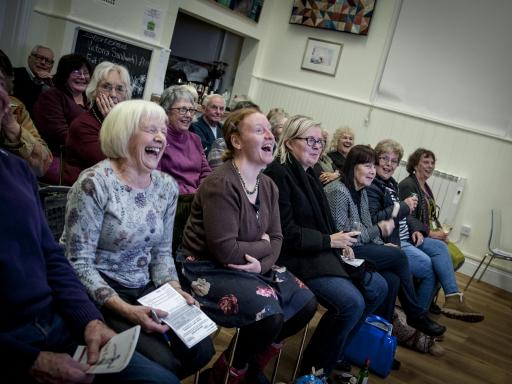 photograph by Trish Thompson of the audience laughing at a Creative Arts East touring event during Creativity & Wellbeing Week 2019