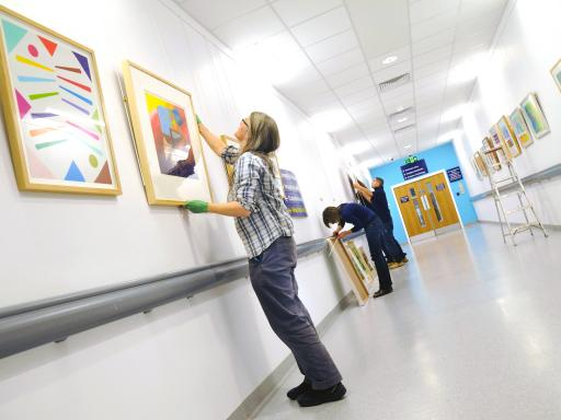 The Paintings in Hospitals team at work at Queen Elizabeth Hospital Birmingham