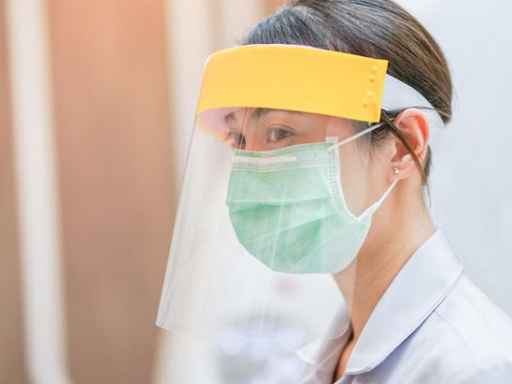 A nurse wearing personal protective equipment